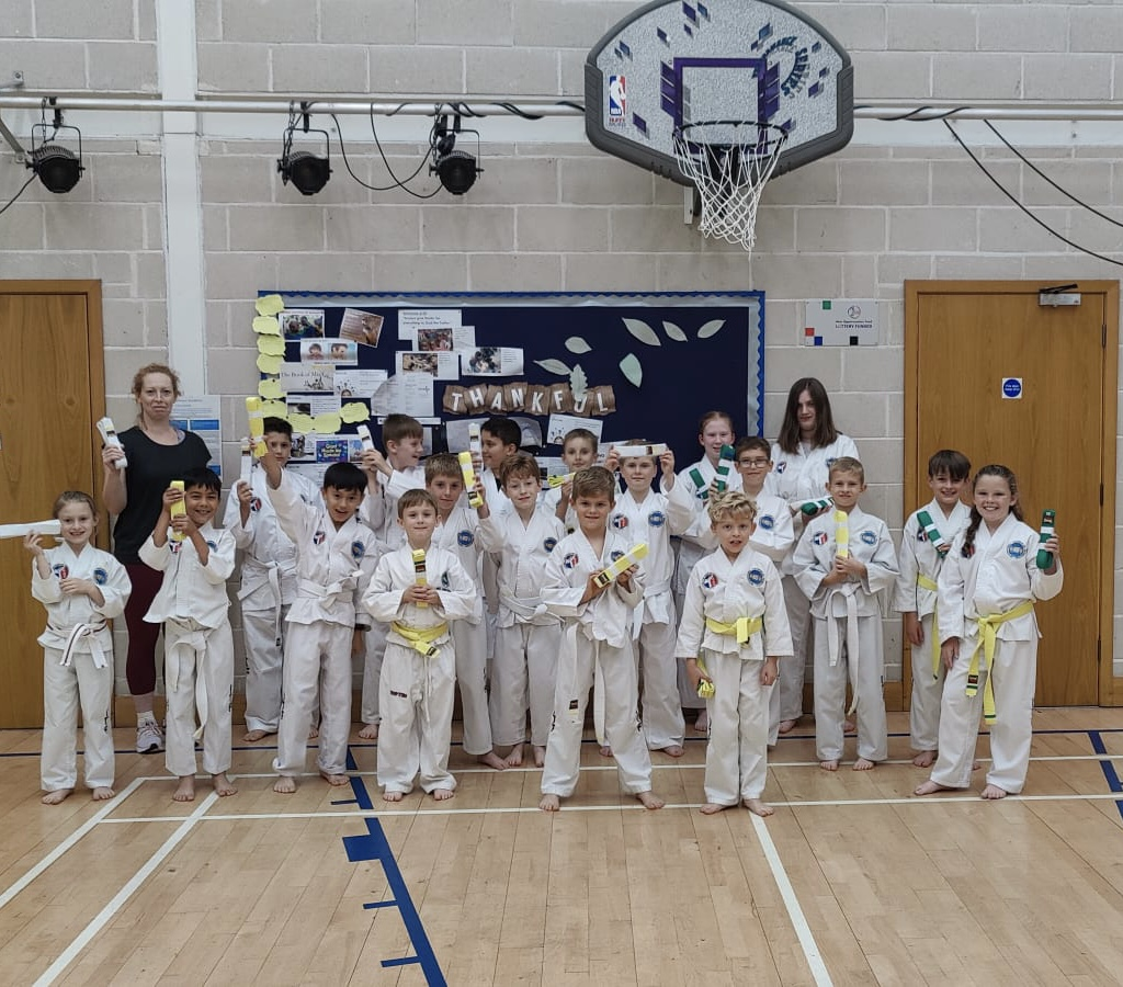 Group photo of students who passed coloured belt grading